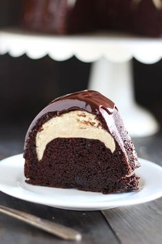 Cheesecake Filled Chocolate Bundt Cake - Rich yet tender chocolate cake, surprise cheesecake filling, and thick fudgy glaze.