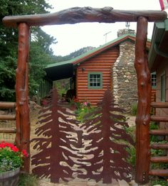 Tree Gate is very unusual. Adds a WOW factor to this cabin entrance.| Content in a Cottage