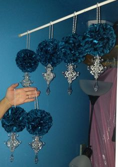 DIY pomander with ornaments ac chandeliers and a roll of beads as carrying handle