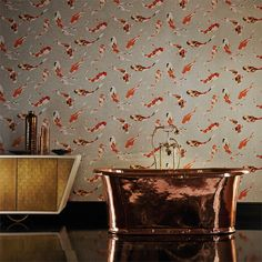 This Harlequin Koi wallpaper design features painterly fish swimming through water. Available from www.silkinteirors.com.au #wallpaper #wallpaperforwalls
