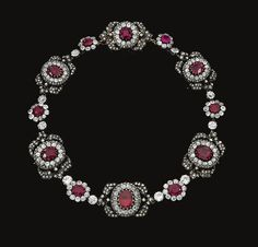 Ruby, Garnet And Diamond Necklace Designed As A Series Of Cluster And Foliate Motifs, Each Set At The Center With Oval And Cushion-Shaped Rubies, The Center Motif set With A Foiled Back Garnet - c.19th Century  -  Sotheby's