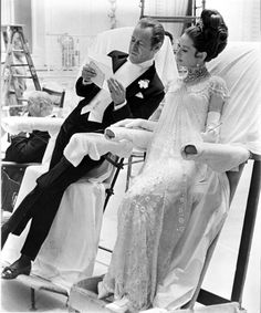 """Rex Harrison, Audrey Hepburn wore a white beaded gown designed by Cecil Beaton, on the set of """"My Fair Lady"""" directed by George Cukor, 1964"""