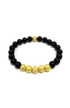 This bracelet is made with high quality matte black onyx beads accented perfectly with gold plated specialty beads. Product is handmade in the USA.