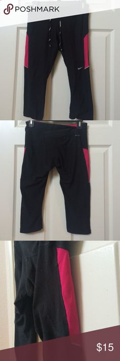 Nike Dri Fit Running Capris Nike Soft Cotton running pant.  Hot pink/fuscia accent color.  92% polyester and 8% spandex Nike Pants Jumpsuits & Rompers