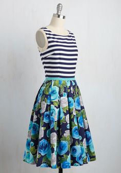 From office parties to bubbly brunches, this pleated A-line is always a thrilling choice! Part of our ModCloth namesake label, this pocketed midi pairs a navy-and-white striped bodice and buttoned back with a floral skirt that assures you're stylishly dressed for both profesh and personal plans.