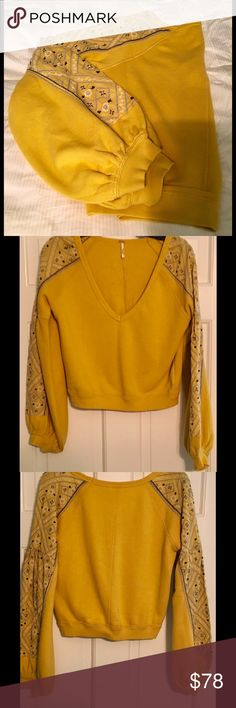 "🆕Listing 💚Gorgeous light mustard color top💚 Free People cropped sweatshirt with embroidery along arms.  Super nice light mustard color. 100% Cotton.  Shoulder 16""; chest 26""; arm length 26.  NWOT Free People Tops Sweatshirts & Hoodies"