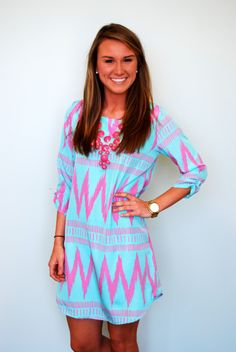 Welcome spring in this new shift dress! We love the arm detail too. Model is 5'5 and wearing a small.