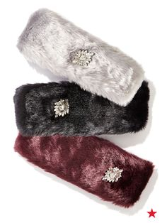 INC International Concepts jeweled faux fur headbands top off her cold weather look in a chic way.