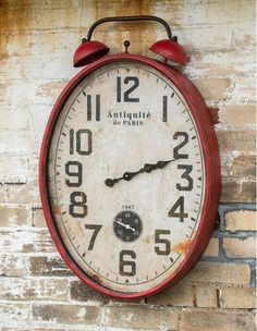 Two-Bell Red Farmhouse Clock-There is just something extra fabulous about a pop of red in your homestead. Add a little red delight with this delightful metal farmhouse clock. The square shape makes a fun industrial statement, and the red ~ well, that will make you smile!