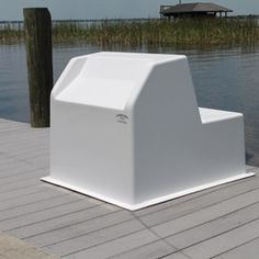 """C&M Marine Center Console with and average fiberglass thickness and seat molded into the console. Perfect for boats 19' to 24' long. 29.5""""H x 33""""w x 39""""D - including flange."""