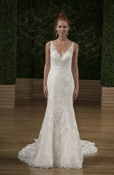 From the new Maggie Sottero Fall 2018 bridal collection, this lace wedding dress features a V-neckline, a sleeveless bodice with illusion straps, all-over embroidered detail, and a fitted trumpet silhouette.