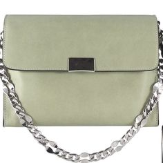 "SALE  Joy Gryson April Handbag - Sage Green Italian cowhide leather all over, flap opening with custom metal tip hardware with magnetic snap, short flat chain shoulder strap, long leather detachable & adjustable shoulder strap, back slide pocket, interior back wall zipper pocket, interior front wall slide pockets, cotton twill lining, interior metal logo plaque. Comes with dust bag 8.5"" x 2"" x 6"" Drop 6""/21"" Joy Gryson Bags Shoulder Bags"