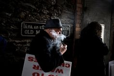 Paulo Nunes dos Santos - Listening to anti-austerity speeches during a demonstration against water fees, seen by many as a new tax, in Killarney, Ireland, in February.
