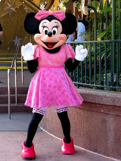 Minnie Mouse in her Star Dress as she works her way to the Mickey Mouse Clubhouse & Minnie with her mini-me | Disneyland Characters and Castles | Pinterest