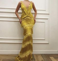Details Yellow dress color Wavy fringe dress fabric Handmade embroidered yellow flowers all over the dress Mermaid gown For parties and special events Long Prom Gowns, Long Evening Gowns, Prom Dresses, Yellow Evening Gown, Evening Party, Elegant Dresses, Beautiful Dresses, Fringe Dress, Fringe Pants