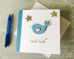 These 5 white handmade cards are perfect for those studying for exams or leaving home.  Leaving the nest is no truer than the wooden bird embellishment on the front, surrounded by silver stars, above Good Luck in silver foil.  This inside had been left blank for your own greeting  This card comes with a blank envelope, all wrapped in clear cellophane for protection during shipping  Choose your colour in variations below (this relates to the bird colour) Good Luck Card, Card for Students…