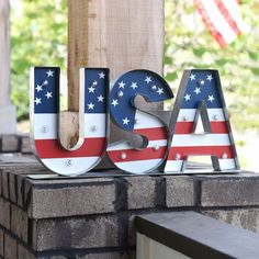 Light up your party with our Pre-Lit Metal USA Tabletop Sign! The vintage-style bulbs give off a soft glow of patriotism over the painted red, white and blue flag details. This rustic sign is the perfect addition to any room!