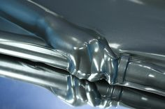 hand in metallic pewter latex vacbed