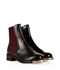 These shoes - I'm in love!! | Modern gilded hardware amps up the edge of these oxblood hued Chelsea boots from Laurence Dacade #Stylebop