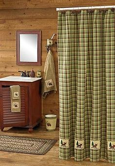 The Juniper Moose Shower Curtain will be a lovely accent to the rustic décor in your bathroom. It features a green and chocolate brown plaid pattern, with moose applique images that are blanket stitched along the bottom, for a striking handcrafted look.