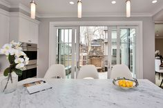 Views to outdoor fireplace from this stunning kitchen!