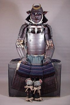 "ARMOR OF SAKAI DAIMYO. Momoyama Ca. 1573-1615,  Namban Dou Gusoku, most likely Myouchin with some Saiga school influence, russet armor with a dou that has western influence,  ""oki te nugui"" style  kabuto, the kote and haidate are heavy plate steel with a ribbing pattern filed into the steel, the suneate are black/dark brown lacquered and match the rest of the armor perfectly with fabric, lacing and lacquer."