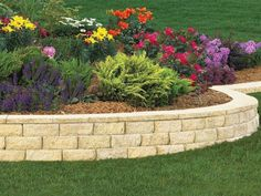To create a cohesive multi-colored landscape or garden bed, bring together hues such as deep purples, pinks, yellows and white flowers. A touch of light blue or pink or a blue-based red might also work, but that depends on the color of the house, says Danna Cain with Home & Garden Design in Atlanta.