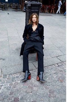 Daria in studded pointed-toe Celine boots