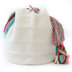 100% Handmade Wayuu Mochila Bags take approximately 14 or more days to complete using the crochet / weaving technique. The braided strap has its own unique design and is also braided by hand. One-Of-A-Kind, Fair Trade, & Certified Wayuu Authentic Art. Made in La Guajira Desert, Colombia Materials: Cotton. Type: Handmade Shoulder Bag with Draw String Tassels. www.wayuutribe.com $158.00