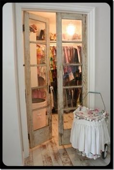 repurposed doors used as closet doors >> perfect for a smaller walk-in closet to make the room seem larger. by proteamundi