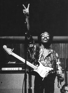 Jimi giving the peace sign