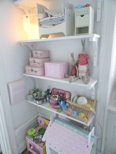 shelf in girl's room. maileg bunnies. princess and the pea playset.