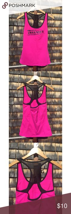 """Insanity Racerback Tank Insanity Racerback Tank Pre-owned - worn a few times, like new Size Medium Nylon/Spandex/Polyester/Mesh Built-in Bra  Pink with black mesh Non-smoking home  15"""" pit to pit  16"""" pit to bottom Beachbody Tops Tank Tops"""