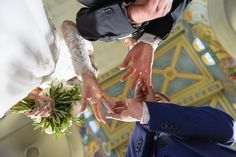 Best man changes wedding rings, view from bellow