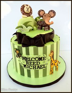 Based on the baby bedding Lambs and Ivy Baby Cocoa this cake features sweet baby safari animals and a brown and green color scheme. The design was inspired by the lamp which matches the bedding.
