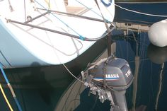 Outboard motor hoist and outboard motor harness for sailing yachts. Sailboat Yacht, Outboard Motors, Sailing, Candle