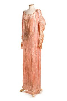 Dress, early 20th century, Mariano Fortuny  Delphos or Greek-style dresses, early 20th century. Designed by Mariano Fortuny, this style of dress was introduced in Venice around 1907 and became the height of fashion. He was noted for perfecting a technique of pleating sheer silk and for his use of natural dyes. The gold gown has Venetian glass beads on the neckline drawstring and the pink one has beads on the long sleeves. They were both worn by Ethel Sanford (1873-1924).