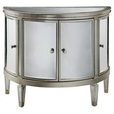 4-door demilune chest with mirrored panels.   Product: ChestConstruction Material: Mirrored glass and engineere...