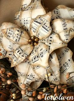 Poinsettias - made from vintage sheet music. Use this as inspiration to make these out of vintage Christmas cards Christmas Paper, All Things Christmas, Vintage Christmas, Christmas Holidays, Christmas Decorations, Christmas Ornaments, Paper Ornaments, Merry Christmas, Book Crafts