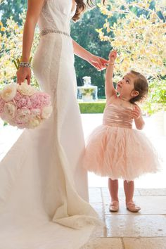 So cute! Blush pink flower girl dress matches the blush pink floral bouquet #blushpink #blushpinkwedding #flowergirl #dress #wedding