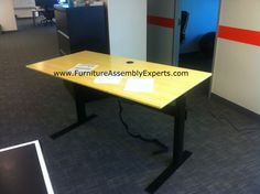 nextdesk terra adjustable height electric desk with bamboo color finish assembled in Washington DC for audax health solutions inc by Furniture Assembly Experts LLC