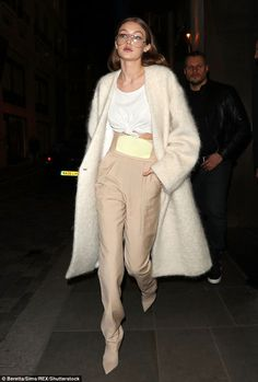 Specs appeal!She has one of the most famous faces in the industry. But Gigi Hadid mixed up her look with a pair of quirky spectacles as she stepped out in London on Monday