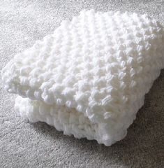 Free Knitting Pattern for 8 Row Repeat Hourglass Eyelet Baby Blanket - Baby blanket with an 8 row repeat honeycomb lace stitch that looks great on both sides. Designed by Lion Brand. Pictured projects by kait-knits and Baby Hat Knitting Patterns Free, Crochet Baby Blanket Free Pattern, Baby Afghan Crochet, Free Knitting, Baby Afghan Patterns, Baby Afghans, Knitting Ideas, Knitting Projects, Knit Crochet