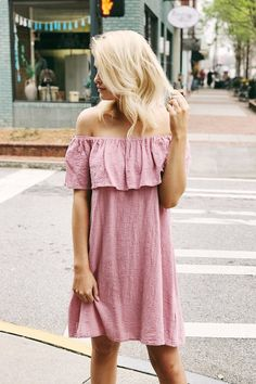 There are three things every girl needs now that the weather is heating up, sun, sand, and probably this dress! This off the shoulder Saltwater Secrets Dress in Dusty Pink has a low elastic neckline w