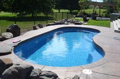 Waterfalls In The Retaining Wall Make This Kidney Shaped Pool Special Located In Bel Air Md