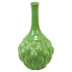 Add a splash of citrus to your living room or bedroom with this spring-ready vase.  Product: VaseConstruction Material: CeramicColor: GreenDimensions: 12 H x 7 DiameterCleaning and Care: Wipe with clean damp cloth