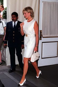 In June of 1997, just months before her tragic death, she attended an auction at Christie's of some of her dresses. She wore a simple white linen dress with Chanel accessories. Always classy, always the personification of grace and elegance. Makes you wonder what wonderful things she would have been doing today. Images courtesy of vogue UK