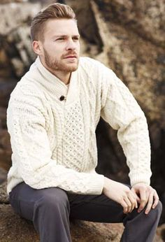What to give a man who appreciates comfort and style?  This traditional Irish wool sweater feels as great as it  looks, thanks to yarn spun from the soft fleece of Merino  sheep, and knitted into beloved patterns—zig-zag, honeycomb,  basket weave and garter  rib. The brown Aran button adds a perfect finishing touch.  Men's sizes L, XL, XXL. From a highly regarded Irish family-  owned company, founded 50 years ago on the Aran Islands.  100% Irish merino wool. Dry clean or hand wash. Mad...