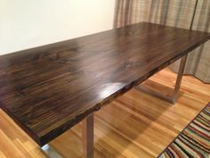 Reclaimed Custom Wood Dining Table with industrial steel frame.  is the top smooth and stain resistant and easy to clean?