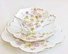 """This Wileman """"Empire"""" shape teacup trio consists of a teacup, saucer and side plate. The flowing shapes of the saucer and the side plate, combined with the proud dignity of the cup with its richly elaborated handle, make it a very stunning set. Vintage Cups, Vintage Tea, Cup And Saucer Set, Tea Cup Saucer, Tea And Crumpets, Chrysanthemum, Metal Dining Table, China Tea Cups, Porcelain Ceramics"""